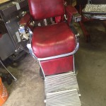 Red barber shop chair restored