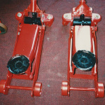red hydraulic jacks repaired